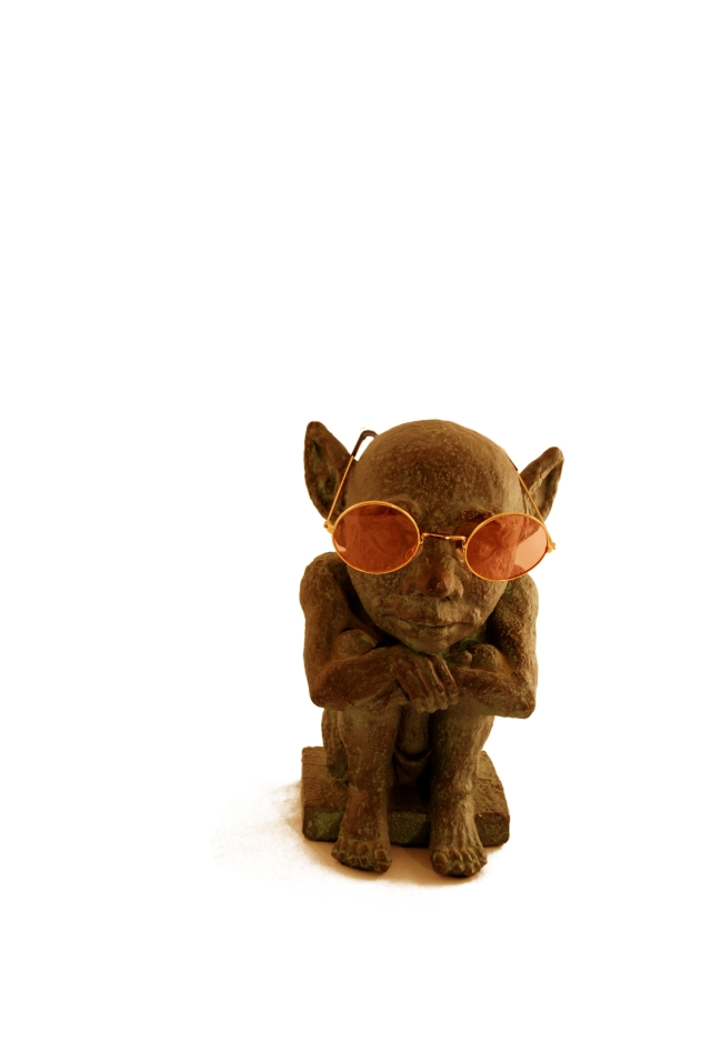 Gargoyle wearing Rose colored glasses from which to view the world with